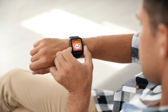 Man with smart watch indoors, closeup view