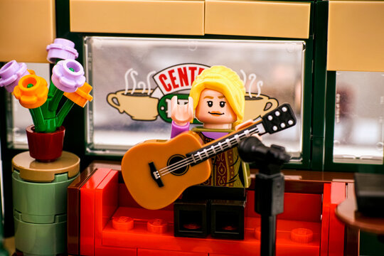 Tambov, Russian Federation - January 03, 2020 Lego Ideas Central Perk set. Lego Phoebe Buffay minifigure performing songs on guitar in Central Perk cafe. Studio shot.