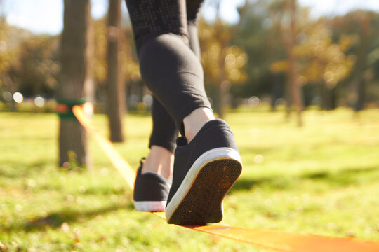 close-up view slacklining feet in springtime at the park
