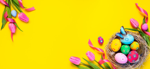 Easter - Colorful Eggs In Nest With Butterfly And Pink Tulips In Yellow Background