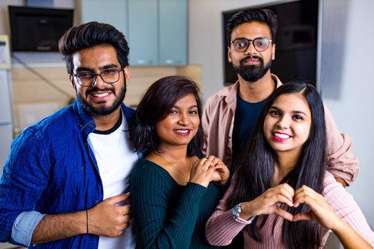 Multiracial best friends millennials at home kitchen