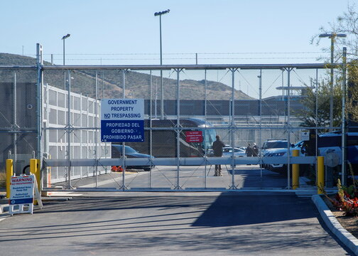A bus leaves a closed border facility in San Diego