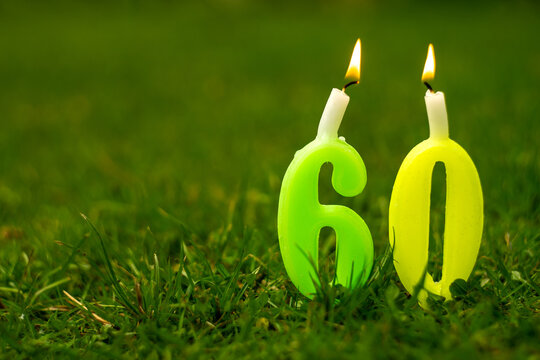Figure 60 of candles with lights on the green grass in the garden in summer