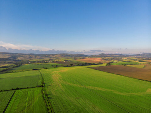 Top view aerial photo of settlements and fields.