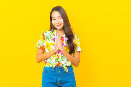 Portrait beautiful young asian woman wear colorful shirt for sonkran festival