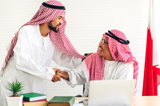 Successful of arab business partner handshake together in modern office.Partnership approval and thanks gesture concept