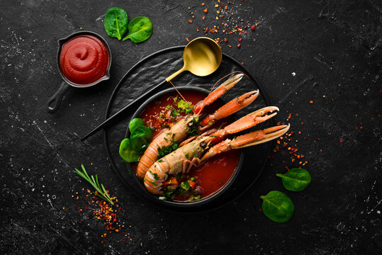 Tomato soup with seafood. Gazpacho soup with lobster and vegetables. Top view. Free space for text.