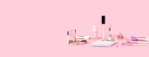 Tender pink monochrome feminine makeup tools and accessories. brushes blush lipstick vanish on...