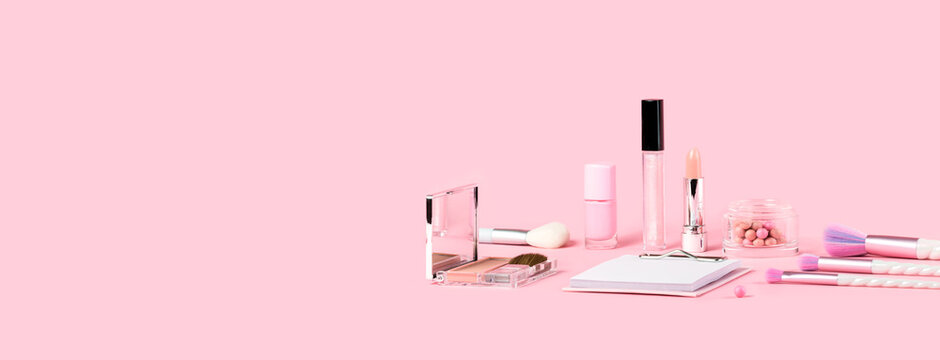 Tender pink monochrome feminine makeup tools and accessories. brushes blush lipstick vanish on candy pink. Birthday beauty cosmetics blogger advert border concept. Copy space