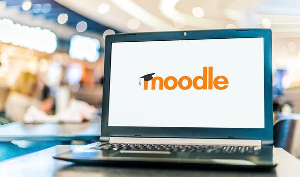 Laptop computer displaying logo of Moodle