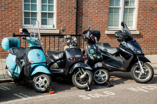 London, UK, March 21, 2009 : Vespa moped and scooters along with a motorbike parked in a solo parking bay in the city centre, stock photo image