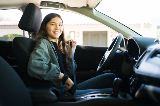 Teenager girl preparing to start her car and drive