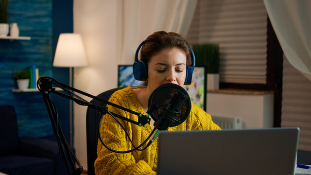 Social media influencer opening laptop starting to record new podcast from home studio. On-air online production internet broadcast show host streaming live content, recording digital video vlog