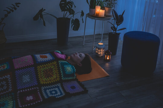 Woman lying in Shavasana, resting after yoga practice