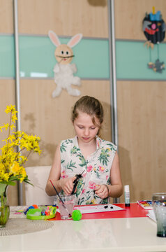 Easter atmosphere at home with children creating Easter craft and colorful decorations