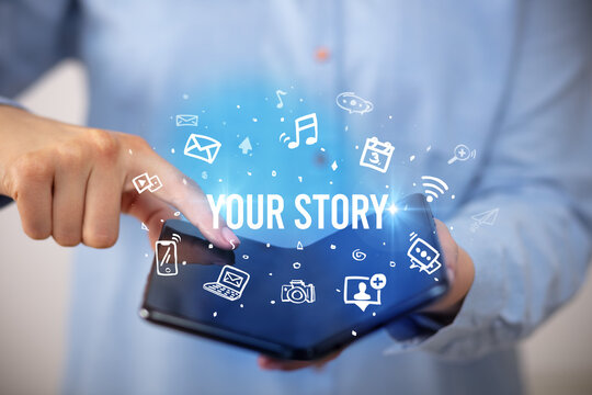 Businessman holding a foldable smartphone with YOUR STORY inscription, social media concept