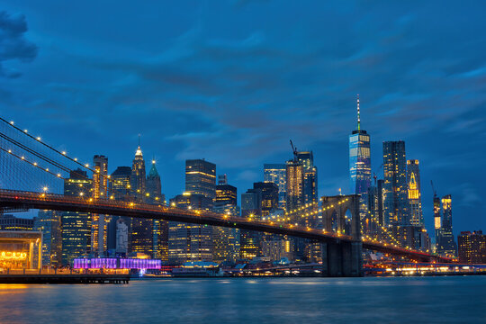 Brooklyn Bridge with panoramic views of  Manhattan at night, New York City, USA