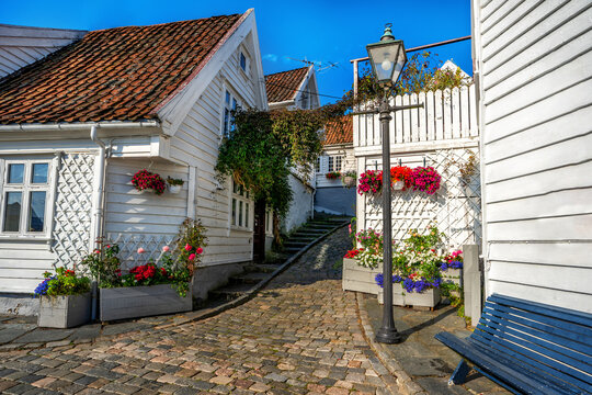 Street with Traditional white wooden houses in Gamle Stavanger