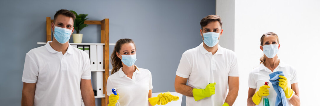Professional Office Cleaning Janitor Team In Uniform