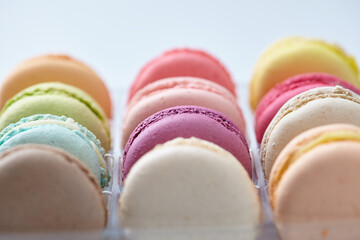 tasty macaroons on the white background