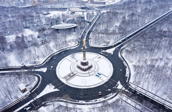 Street traffic  of the victory column in winter in Berlin, Germany.
