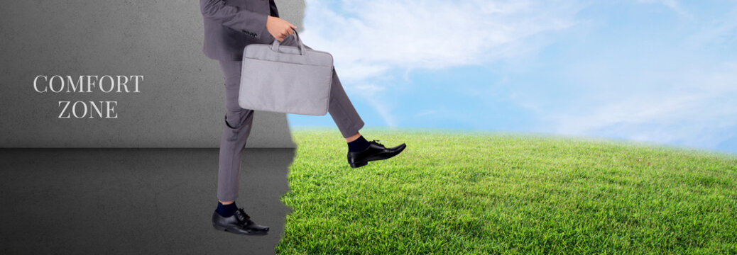 Businessman walking outside comfort zone for success, man decision for succeed cross path with confidence, metaphor, male decide ahead for challenge, achievement and aspiration, business concept.