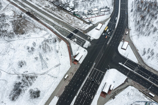 aerial view of a crossroad in the city suburb at chilly winter day
