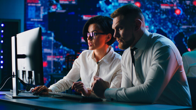 Woman showing digital security data to colleague