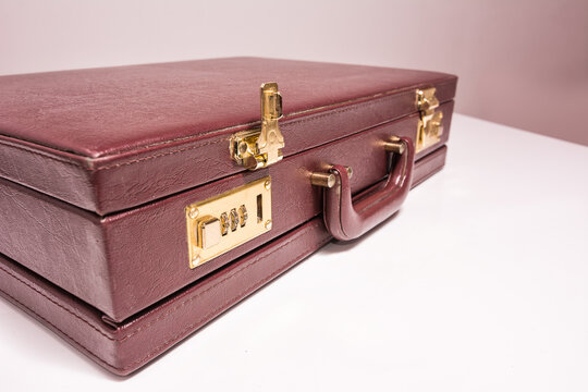Closed 24 hour briefcase with open lock