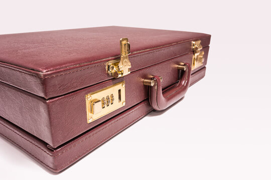 Closed 24 hour briefcase with open lock on white background