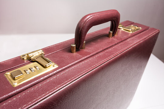 Closed 24 hour briefcase with closed lock on white background