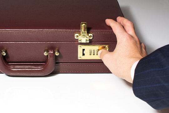 24-hour briefcase with hand that releases the lock