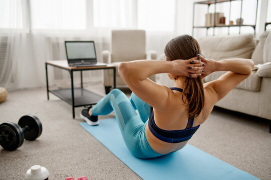 Girl doing abs exercise, online fit training