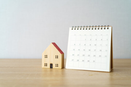 A calendar of the month with model house model. using as background business concept and Planning concept with copy spaces and white space for your text or design.