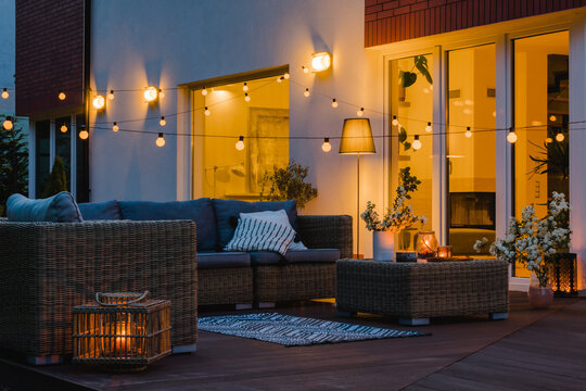 Summer evening on the patio of beautiful suburban house with garden
