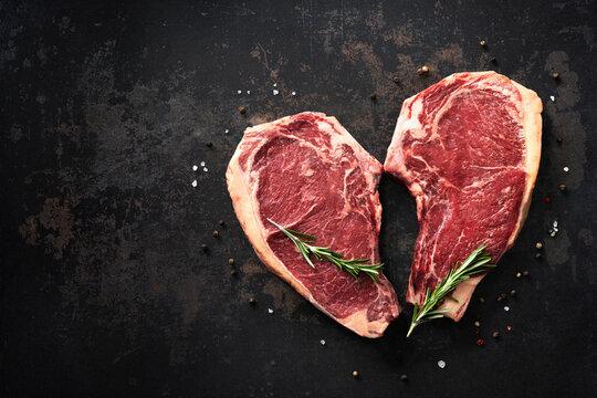 Heart shape raw dry aged beef rib steaks (cote de boeuf)