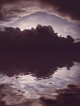 Clouds on the calm sea al evening