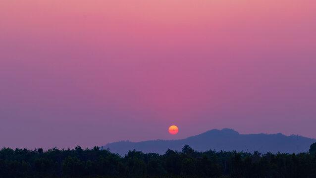 Evening twilight sky with sunset and mountain view, Purple nightfall silhouette mountain, Dawn sun light over mountain