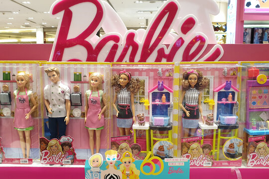 Shelves of Barbie doll toys display in Siam Paragon Mall. Barbie is a fashion doll manufactured by the American toy-company Mattel and launched in March 1959. BANGKOK, THAILAND - 7 APR 2019.