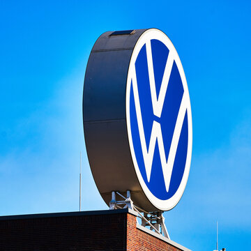 Volkswagen logo on the administrative building of the headquarters at the car factory in Wolfsburg, Germany, February 21, 2021