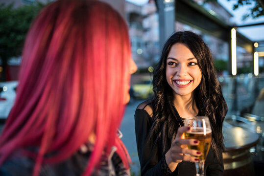 pretty women have a happy conversation in a bar