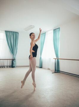Young ballerina practice classical ballet