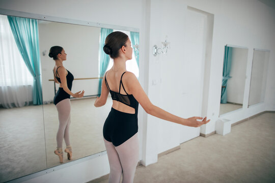 Classical ballet dancer side view
