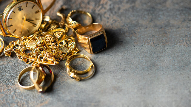 Old and broken jewelry, vintage watches on dark background. Sell  gold  for cash concept.