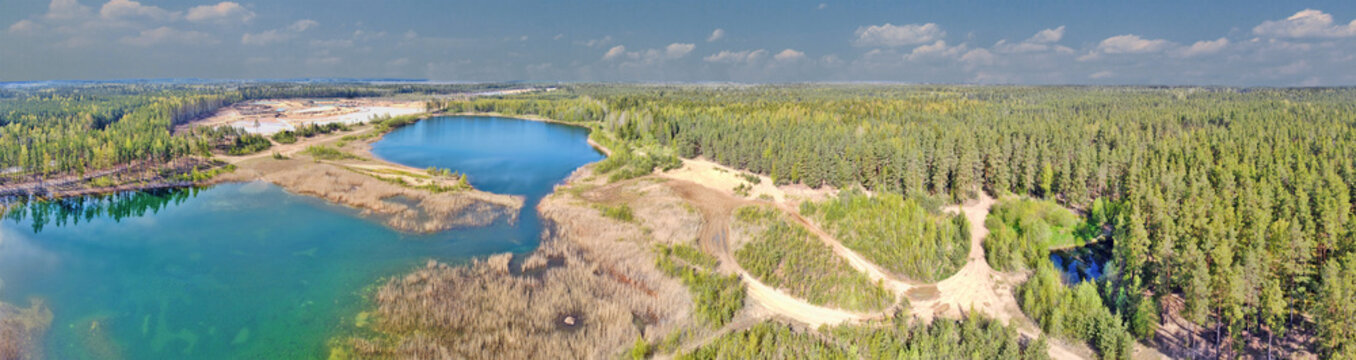 roads to lakes in pine forest aerial view