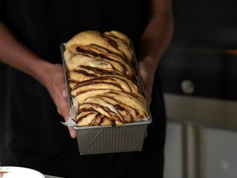person holding a babka