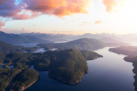 Aerial view of Nelson Island during a sunny summer morning. Sunrise Sky Art Render. Taken in Sunshine Coast, BC, Canada.
