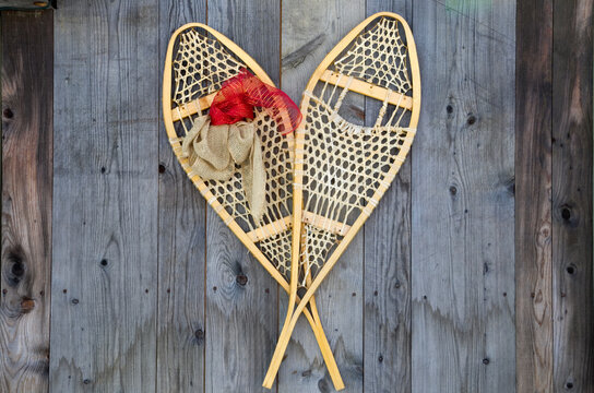 Antique Snowshoes on a Weathered Wood Barn Wall