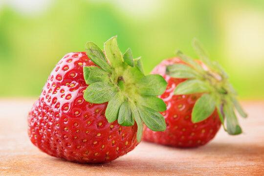 Fresh ripe red sweet strawberries on wooden board