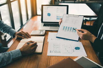 Fototapeta Business partnership pointing to the graph of the company financial statements report and profits earned during in the office. obraz